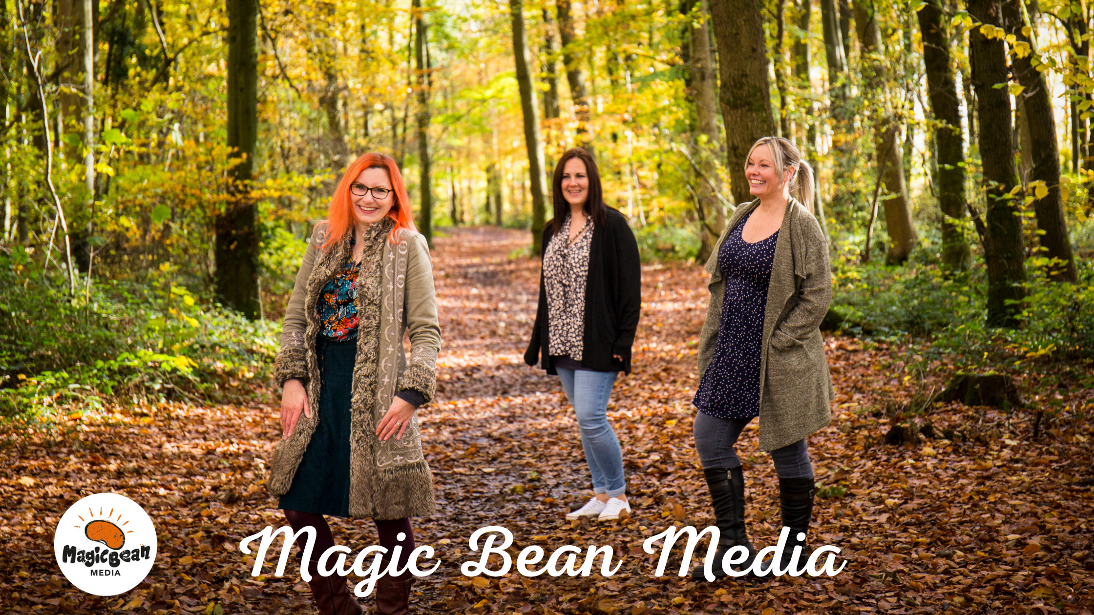 Three ladies stood in the woods